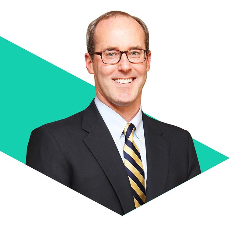 Photo of J. Christopher Greenawalt, MD, inside a green triangular shape